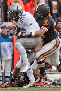 U of O RB Kenjon Barner (24) tries to escape the tackle of Oregon State  LB Keith Pankey (35) during the 2010 Civil War game at Reser Stadium, Corvallis, Oregon.  The Oregon Ducks beat the Oregon State beavers 40-20.
