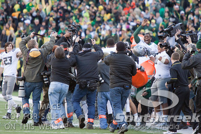 Oregon players douse their coach with water after a 2010 Civil War victory at Reser Stadium, Corvallis, Oregon.  The Oregon Ducks defeated the Oregon State Beavers 37-20 to advance to the BCS National Championship game in Glendale, Arizona.