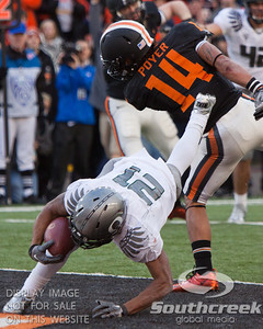 Oregon Rb LaMichael James (21) dives for a touchdown past Oregon State CB Jordan Poyer (14) during second half the the 2010 Civil War game at Reser Stadium, Corvallis, Oregon.  The Oregon Ducks beat the Oregon State beavers 40-20.