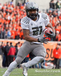 Oregon RB LaMichael James (21) makes a cut during the 2010 Civil War game at Reser Stadium, Corvallis, Oregon.  The Oregon Ducks defeated the Oregon State Beavers 37-20 to advance to the BCS National Championship game in Glendale, Arizona.