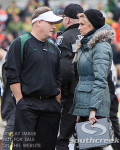 Oregon coach Chip Kelly (left) prepares to talk to ESPN's sideline reporter Erin Andrews during half time at the 2010 Civil War game at Reser Stadium, Corvallis, Oregon.  The Oregon Ducks defeated the Oregon State Beavers 37-20 to advance to the BCS National Championship game in Glendale, Arizona.