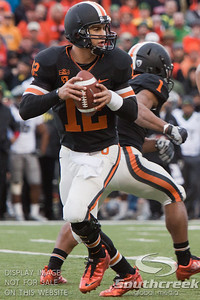 Oregon State QB Ryan Katz (12) drops back to pass during the 2010 Civil War game at Reser Stadium, Corvallis, Oregon.  The Oregon Ducks defeated the Oregon State Beavers 37-20 to advance to the BCS National Championship game in Glendale, Arizona.