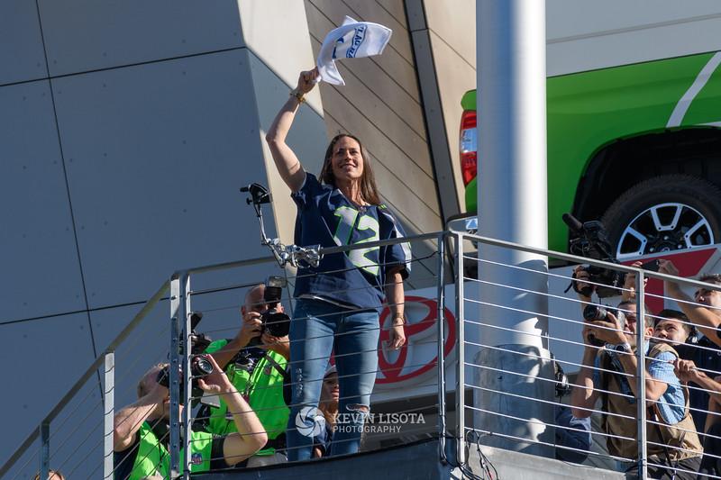 Sue Bird raises 12th Man Flag