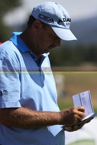 Brad Bryant marks his scorecard