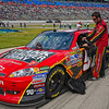 Crew member attending to car before the NASCAR AAA Texas 500 @ Texas Motor Speedway
