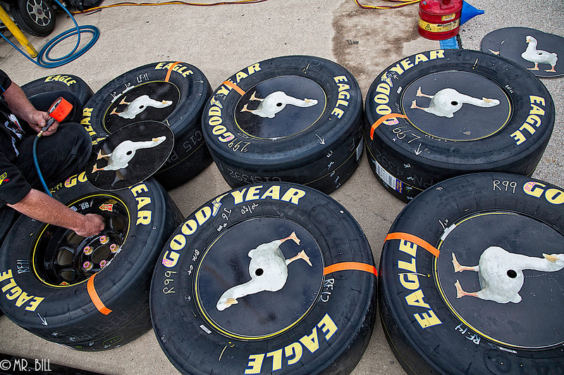 Crew member inflating tires of Carl Edwards car before the NASCAR AAA Texas 500 @ Texas Motor Speedway