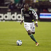 Portland Timbers midfielder James Marcelin (14) runs the ball up field. Portland defeated Chicago 4-2 in the rain at the home opener at Jeld-Wen Field in Portland, Oregon