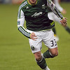 Portland Timbers forward Kenny Cooper (33) runs the ball up field in the second half. Portland defeated Chicago 4-2 in the rain at the home opener at Jeld-Wen Field in Portland, Oregon