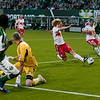New York Red Bulls defender Stephen Keel (22), scores a own goal while trying to block a kick from Portland Timbers forward Jorge Perlaza (15). Portland tied New York 3-3 at Jeld-Wen Field in Portland, Oregon