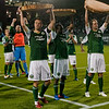 Portland Timbers midfielder Jack Jewsbury (13), Portland Timbers defender Steve Purdy (25) and Portland Timbers defender Kevin Goldthwaite (2) hold up their slices of wood symbolizing their goals.  Portland tied New York 3-3 at Jeld-Wen Field in Portland, Oregon
