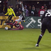 Portland Timbers defender Steve Purdy (25) falls over Chicago Fire defender Cory Gibbs.  Portland defeated Chicago 4-2 in the rain at the home opener at Jeld-Wen Field in Portland, Oregon