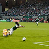 New York Red Bulls goalkeeper Greg Sutton (24) takes down Portland Timbers forward Jorge Perlaza (15) as he goes in for a goal. Sutton was given a yellow card for the play. The resulting penalty kick was a miss. Portland tied New York 3-3 at Jeld-Wen Field in Portland, Oregon