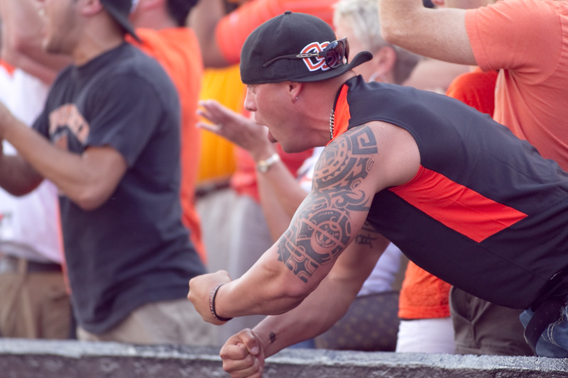 A fan celebrates a OSU first down during the OSU vs UCLA game at Reser Stadium in  Oregon. UCLA went on to defeat OSU 27-19.