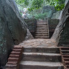 First part of the climb with steps and large rocks and trees. The rock is 200 m. higher than surrounding jungle and has a King's palace ruins on the top built in the 5th C. It is a UNESCO World Heritage Site. Before and after the Kings who lived there it was a Buddhist monastery.