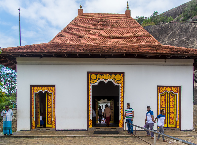 On our way to Kandy as we left the cultural triangle we stopped at the Dambulla Cave Temple. Many stairs up, this is the entrance to the complex.