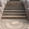 Beautiful carved elephants and other animals on the stone entrance and steps.