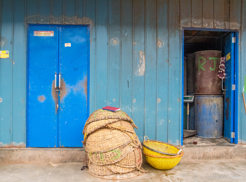 Storage sheds and baskets in the dried fish market area.