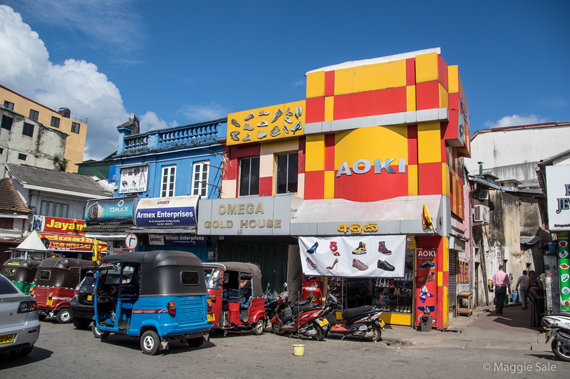 Colourful stores in central Kandy - with the ever present tuk-tuk's and motorcycles.