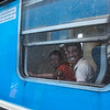 Taken through two dirty windows at another station - everyone friendly and smiling and waving on the trains.