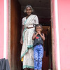 Grandmother and child in their doorway.