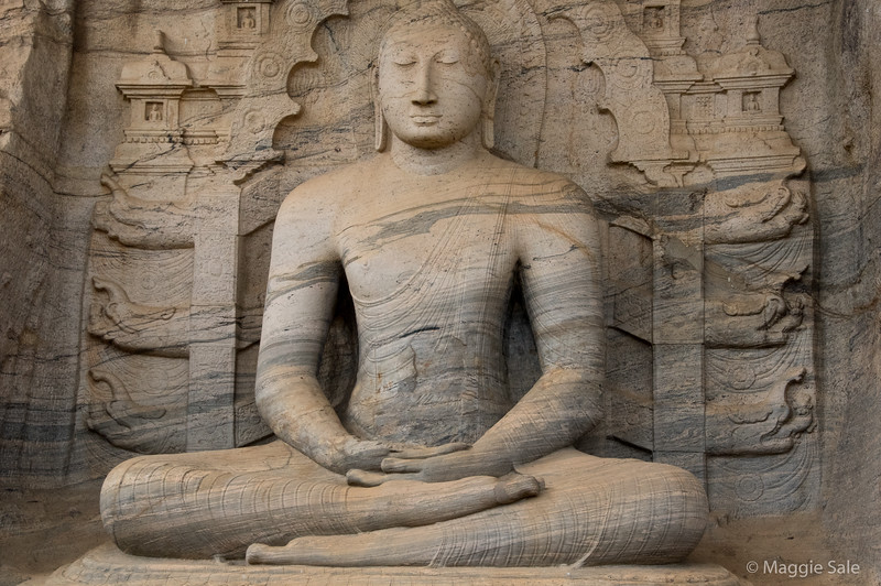 A beautiful large stone sitting Buddha, one of four carved out of the same piece of granite at Gal Vihara, Polonnaruwa.