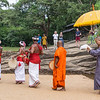 Luckily, while we were looking at the Buddhas, a visiting group of Japanese monks came to the site with offerings, accompanied by pipers and drummers and Sri Lankan monks in orange.