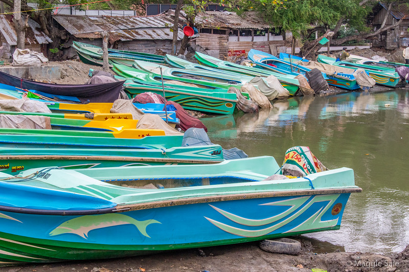 Small motor fishing boats with colourful designs.