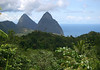 From the northeastern slopes of Mt. Tabac - across the tropical forest - to the Petit and beyond the Gross Pitons, with their summits just in the cumulus clouds at around 2,438 ft. (743 m) and  2,525 ft. (770 m) - with the Caribbean Sea below.