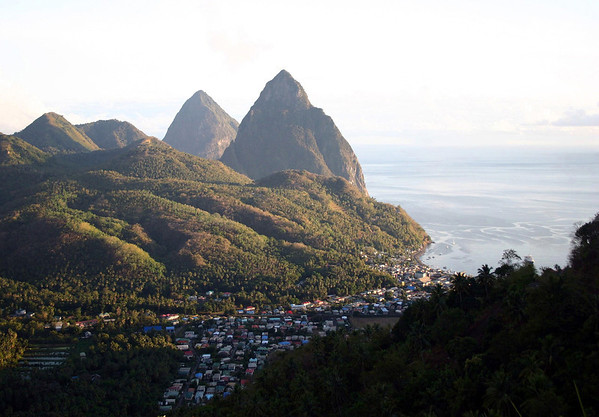 Late evening sunlight upon Soufrière Bay and town - the Piton Mitan Ridge - and the northern slopes of the Twin Pitons