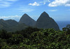 "Beyond the tropical forest along the Piton Mitan Ridge - over to the pyramidal lava domes of Petit Piton (foreground) which is about 88 ft. (27 m) lower - the Gros Piton, which is about 1.5 mi. (2.4 km) southward, from summit to summit - all three part of the ""Pitons Management Area"" which is was designated in 2004, as a UNESCO World Heritage Site"
