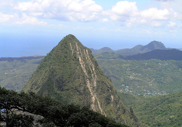 From the peak of Gros Piton - 1.5 mi. (2.4 km) across to the slightly lower summit of Petit Piton - and Mt. Regnier (partially sunlit and shaded) about 7 mi. (11 km) northward