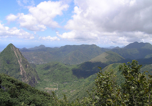 From the summit of Gros Piton - viewing northeastward to the Petit Piton and the Quailbou Depression, a collapsed strata (composite) volcano, measuring about 4.3 mi. (7 km) diameter - with the distal Mt. Regnier (L, sunlit), Mt. Tabac (C, beyond the cloud shadow), and Mt. Gimie (R, shaded) which is the tallest point on St. Lucia, rising to 3,117 ft. (950 m)
