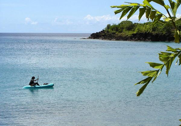 Local fisherman cruising in a kayak
