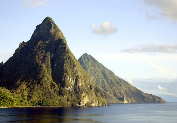 Afternoon sunlight upon the Petit and Gross Pitons - rising 2,436 ft. (743 m) and 2,526 ft. (770 m) - from across Soufrière Bay