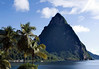 Beyond the coconut palm trees and Soufrière Bay - to the mostly shaded north face of the volcanic dome of Petit Piton - rising to 2,438 ft. (743 m) above the Caribbean Sea