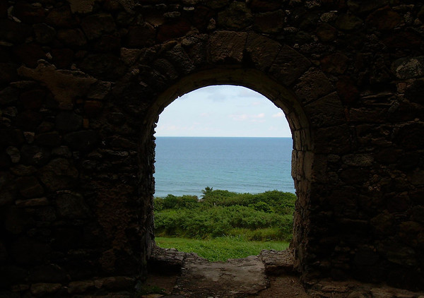 From within a masonry stone Sugar Mill (wind mill) - out into the Caribbean Sea