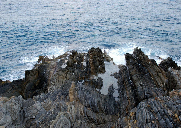 Tide pool upon the sedimentary rock at Point Udall - easternmost point of all U.S. territory