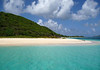 Across the turquoise-colored waters of the Caribbean Sea - to the western sand beach at Buck Island - viewing southeast across Diedrichs Point - to the distal Point Udall, the eastern most tip of St. Croix - below the cumulus clouds above