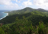 Viewing from Maroon Ridge (northwestern island) - to Mount Eagle, rising to 1,088 ft. (332 m) - and beyond right is Blue Mountain, the highest point on St. Croix, at 1,096 ft. (334 m) - with Cane Bay along the northwestern shoreline