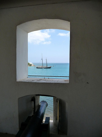 Fort Christiansvaern - into the Christiansted Harbor, with the northeastern tip of Protestant Cay, seen beyond the morred sailing ship