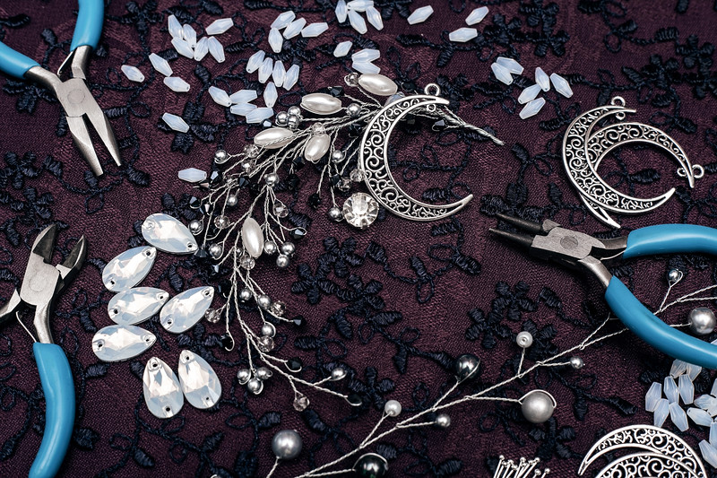 Creative tools for fashion design and jewelry creation. Beautiful jewelry manufacturing and tools. Vintage background for needlework