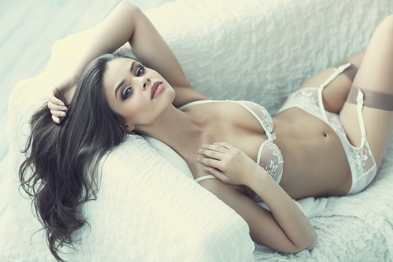 close up portrait of beautiful alluring young woman in white sexy lingerie