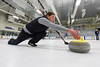 Team BLT's Laura Crawford releases a stone during Sunday Nights Curling Championship Game against the Harry Stones.