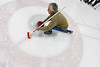 "Harry Stones player Barry Koncinski slides over the ""house"" as he prepares to release the rock during Sunday Nights Curling Championship Game against the BLT's."