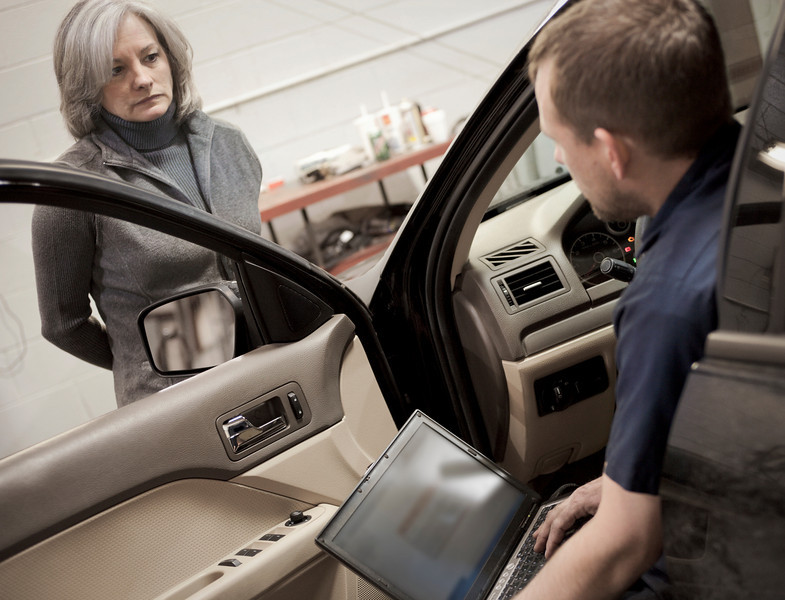"""Auto mechanic gives woman news about her car.  <a href=""""http://www.istockphoto.com/file_search.php?action=file&lightboxID=5706230"""">Available for purchase from William Britten iStockphoto</a>"""
