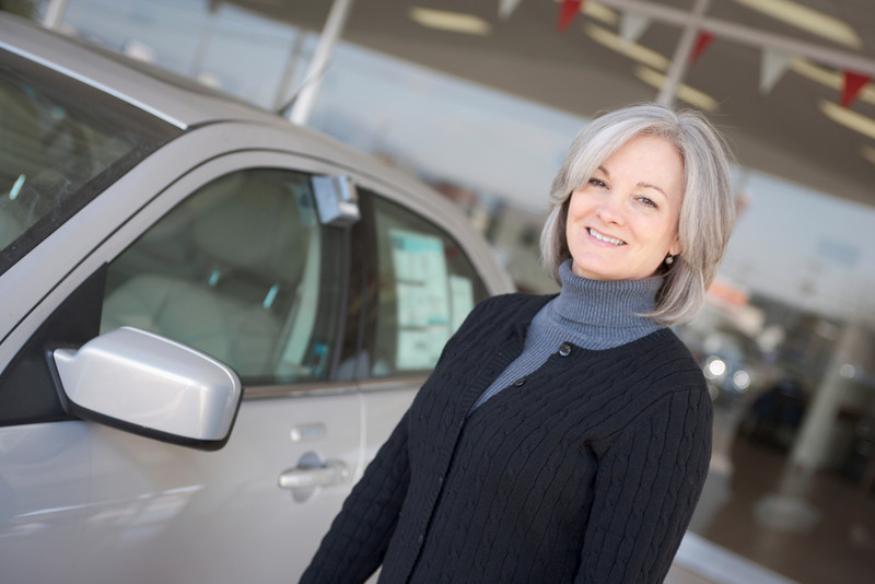 "Woman purchases new car.  <a href=""http://www.istockphoto.com/file_search.php?action=file&lightboxID=5706230"">Available for purchase from William Britten iStockphoto</a>"
