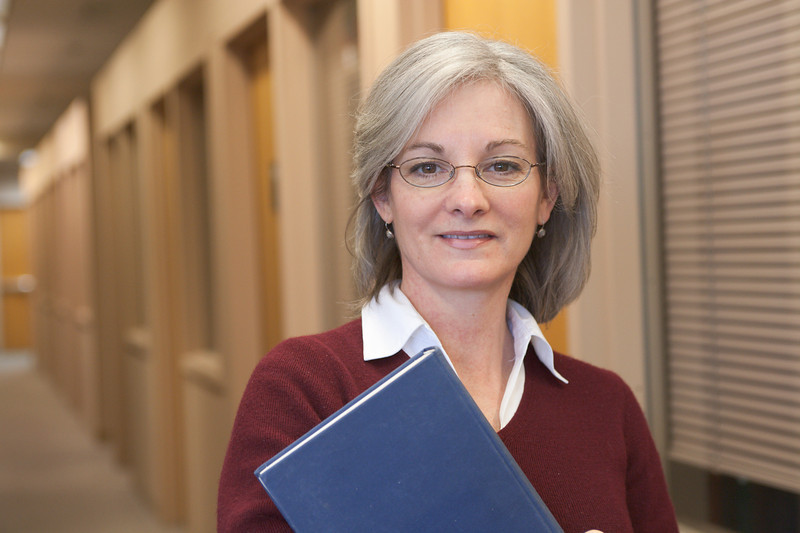 """Attractive librarian or adult student. <a href=""""http://www.istockphoto.com/file_search.php?action=file&lightboxID=5540504"""">Available for purchase from William Britten iStockphoto</a>"""