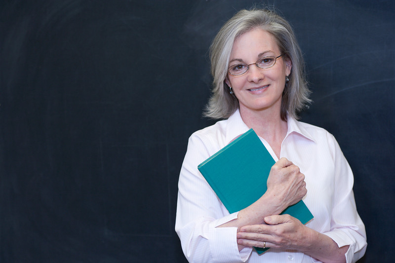 """Attractive teacher or student at a blackboard. <a href=""""http://www.istockphoto.com/file_search.php?action=file&lightboxID=5540504"""">Available for purchase from William Britten iStockphoto</a>"""