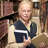 "Professor in a library. <a href=""http://www.istockphoto.com/file_search.php?action=file&lightboxID=5540504"">Available for purchase from William Britten iStockphoto</a>"