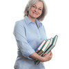"""Woman with books. <a href=""""http://www.istockphoto.com/file_search.php?action=file&lightboxID=5540504"""">Available for purchase from William Britten iStockphoto</a>"""